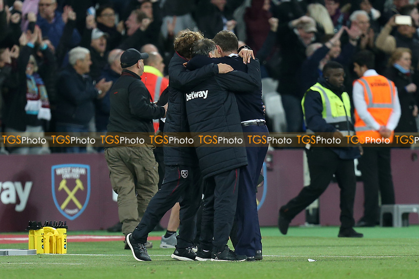 West Ham United manager celebrates with his staff after West Ham United vs Tottenham Hotspur, Premier League Football at The London Stadium on 5th May 2017