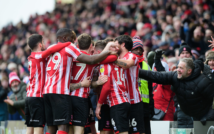 Lincoln City's Harry Toffolo (number 14) celebrates scoring the opening goal with team-mates<br /> <br /> Photographer Chris Vaughan/CameraSport<br /> <br /> The EFL Sky Bet League Two - Lincoln City v Grimsby Town - Saturday 19 January 2019 - Sincil Bank - Lincoln<br /> <br /> World Copyright &copy; 2019 CameraSport. All rights reserved. 43 Linden Ave. Countesthorpe. Leicester. England. LE8 5PG - Tel: +44 (0) 116 277 4147 - admin@camerasport.com - www.camerasport.com