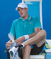 JOHN ISNER (USA)  against DAVID NALBANDIAN (ARG) in the second round of the Men's Singles. John Isner beat David Nalbandian 4-6 6-3 2-6 7-6 10-8..18/01/2012, 18th January 2012, 18.01.2012..The Australian Open, Melbourne Park, Melbourne,Victoria, Australia.@AMN IMAGES, Frey, Advantage Media Network, 30, Cleveland Street, London, W1T 4JD .Tel - +44 208 947 0100..email - mfrey@advantagemedianet.com..www.amnimages.photoshelter.com.