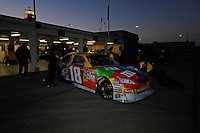 The car of Kyle Busch (#18) is wheeled through the garage.