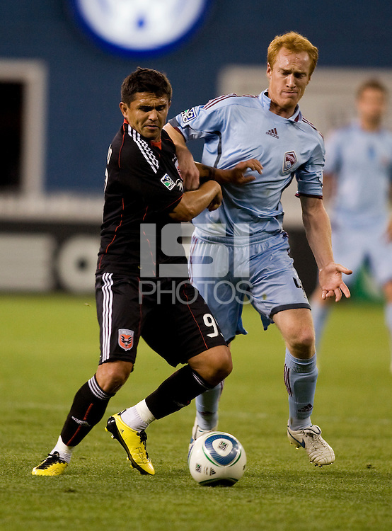 Jaime Moreno (9) of D.C. United fights for the ball with Jeff Larentowicz (4) of the Colorado Rapids at RFK Stadium in Washington, DC.  The Colorado Rapids defeated D.C. United, 1-0.