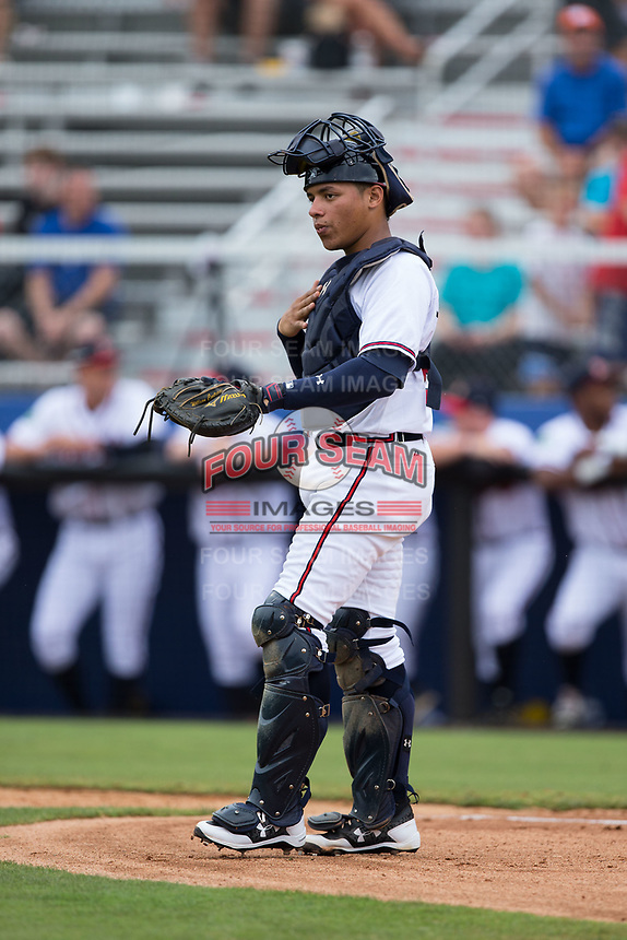 Danville Braves catcher William Contreras (24) gives signs to his defense during the game against the Princeton Rays at American Legion Post 325 Field on June 25, 2017 in Danville, Virginia.  The Braves walked-off the Rays 7-6 in 11 innings.  (Brian Westerholt/Four Seam Images)