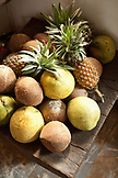 VIETNAM, Saigon, Cuc Gach Quan restaurant in District 1, fruit displayed on a small table at the entry of the restaurant, Ho Chi Minh City
