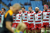James Hook, Paddy McAllister, John Afoa and Tom Savage of Gloucester Rugby look on as the Wasps team enter the field. Aviva Premiership match, between Wasps and Gloucester Rugby on November 8, 2015 at the Ricoh Arena in Coventry, England. Photo by: Patrick Khachfe / Onside Images