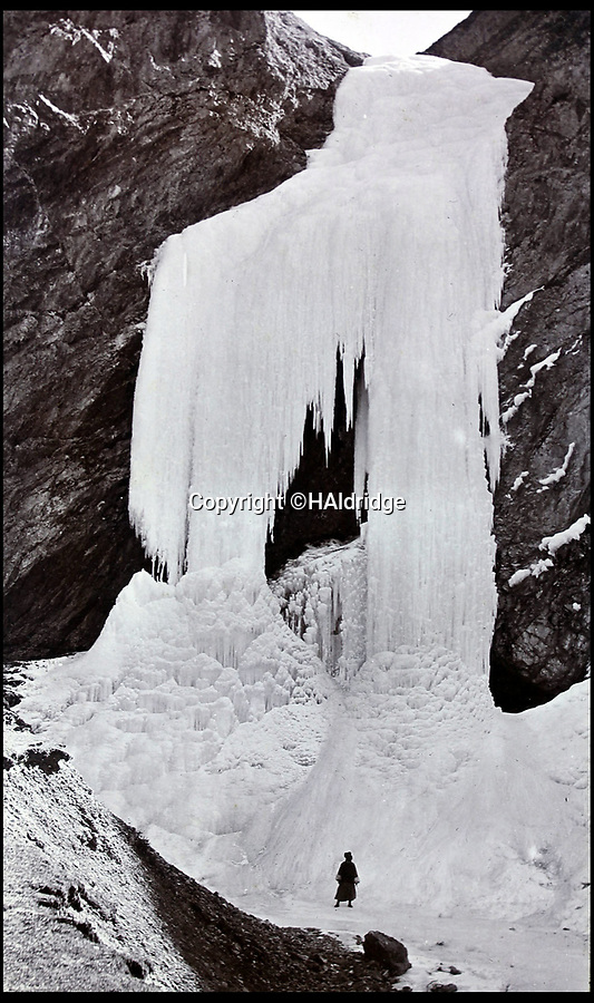 BNPS.co.uk (01202 558833)Pic: HAldridge/BNPS<br /> <br /> Frozen waterfall.<br /> <br /> Game tales from the hills...remarkable album shows British attempts to win over newly invaded Tibet by playing sport's straight from the playing fields of England.<br /> <br /> A collection of photos have come to light which show the people of the remote Himalayan nation of Tibet embracing one of the traditional British pastimes - a sports day.<br /> <br /> The archive of more than 500 photos was collated by a British Lieutenant Colonel, R C MacGregor, of the Indian Medical Service, who was present in Tibet between 1904 and 1912.<br /> <br /> These photos are one of the earliest examples of the British attempting to win 'the hearts and minds' of a native population as they were taken during the controversial Younghusband expedition to the distant Buddhist country.<br /> <br /> The archive also features four never before seen photos of the Dalai Lama returning to Tibet in 1912 after his exile ended.