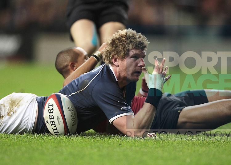 Adam Thompson of the Southern Hemisphere celebrates a try during the Help the Heroes Rugby Challenge