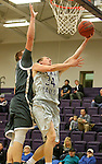 SIOUX FALLS, SD - DECEMBER 8:  Clint Thomas #34 from the University of Sioux Falls takes the ball to the basket against Mitch Weg #5 from Southwest Minnesota State Tuesday night at the Stewart Center. (Photo by Dave Eggen/Inertia)