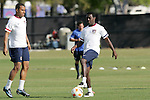 12 March 2008: Freddy Adu (USA) (right) traps the ball as Charlie Davies (USA) (left) looks on. The United States U-23 Men's National Team practiced at the Tampa Bay Buccaneers training facility in Tampa, FL on an off day in the 2008 CONCACAF Men's Olympic Qualifying Tournament.
