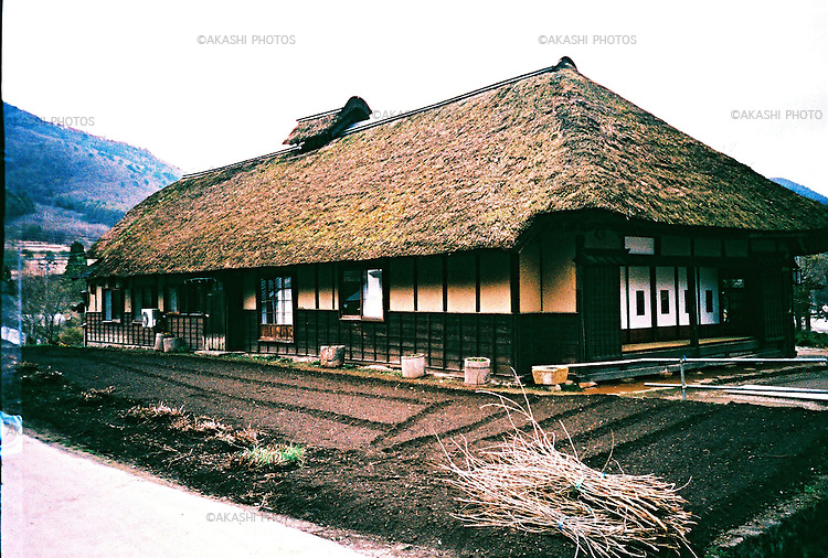 A traditional Japanese house with thatched roof in Ouchi-Juku village in Fukushima.