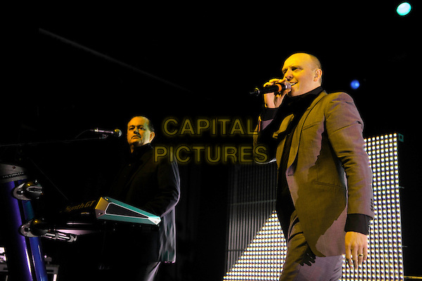 HEAVEN 17- Martyn Ware & Glenn Gregory.Heaven 17 performs on stage at HMV Forum, London, England. .November 28th, 2010.stage concert live gig performance music half length brown beige suit singing keyboards  .CAP/MAR.© Martin Harris/Capital Pictures.