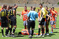 The teams gather round after Wellington's Adam Birch is sent off by referee Campbell Waugh..NZFC soccer  - Team Wellington v Waikato FC at Newtown Park, Wellington. Sunday, 20 December 2009. Photo: Dave Lintott/lintottphoto.co.nz