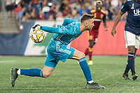 FOXBOROUGH, MA - SEPTEMBER 21: Matt Turner #30 of New England Revolution passes the ball down the field during a game between Real Salt Lake and New England Revolution at Gillette Stadium on September 21, 2019 in Foxborough, Massachusetts.