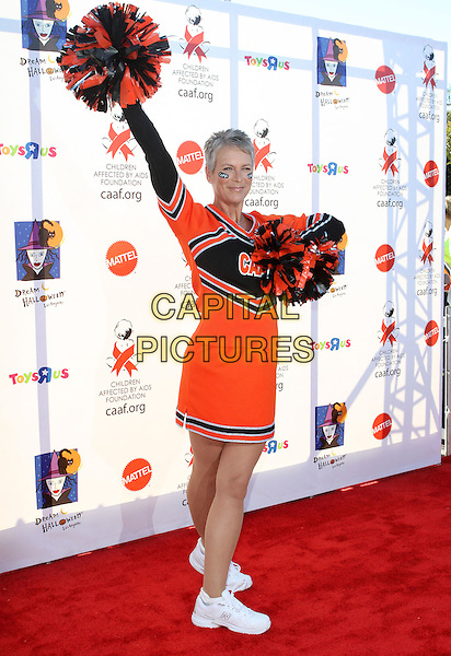 JAMIE LEE CURTIS.17th Annual Dream Halloween to benefit the Children Affected by Aids Foundation held at Barker Hanger,  Santa Monica, CA, USA, .30th October 2010..full length cheerleader costume outfit dressed up face paint black orange red pom poms hand on hip arm raised up white trainers.CAP/ADM/KB.©Kevan Brooks/AdMedia/Capital Pictures.