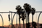 Man climbing pole at playground on Santa Monica Beach in Los Angeles; CA