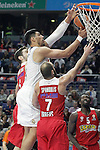 Real Madrid's Gustavo Ayon (c) and Olympimpiacos Piraeus' Ioannis Papapetrou (l) and Vassilis Spanoulis during Euroleague match. January 28,2016. (ALTERPHOTOS/Acero)
