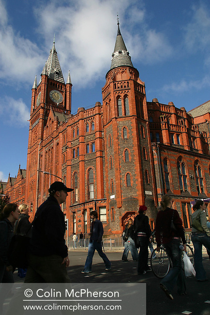 Students crossing Brownlow Hill to classes and lectures at the University of Liverpool with the university's Victoria Building in the background.