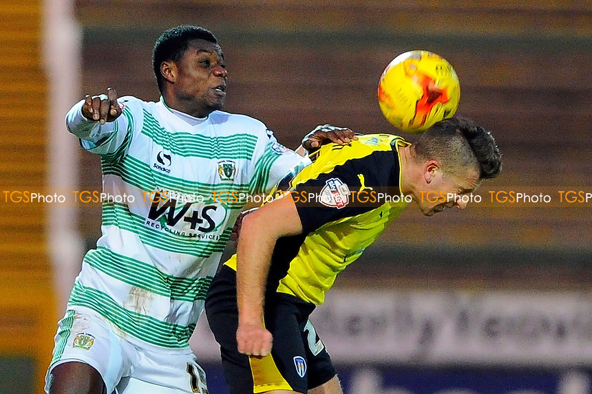 Seth Twumasi of Yeovil Town left and George Moncur of Colchester United vie for a headerand  - Yeovil Town vs Colchester United - Sky Bet League One Football at Huish Park, Yeovil - 20/12/14 - MANDATORY CREDIT: Denis Murphy/TGSPHOTO - Self billing applies where appropriate - contact@tgsphoto.co.uk - NO UNPAID USE