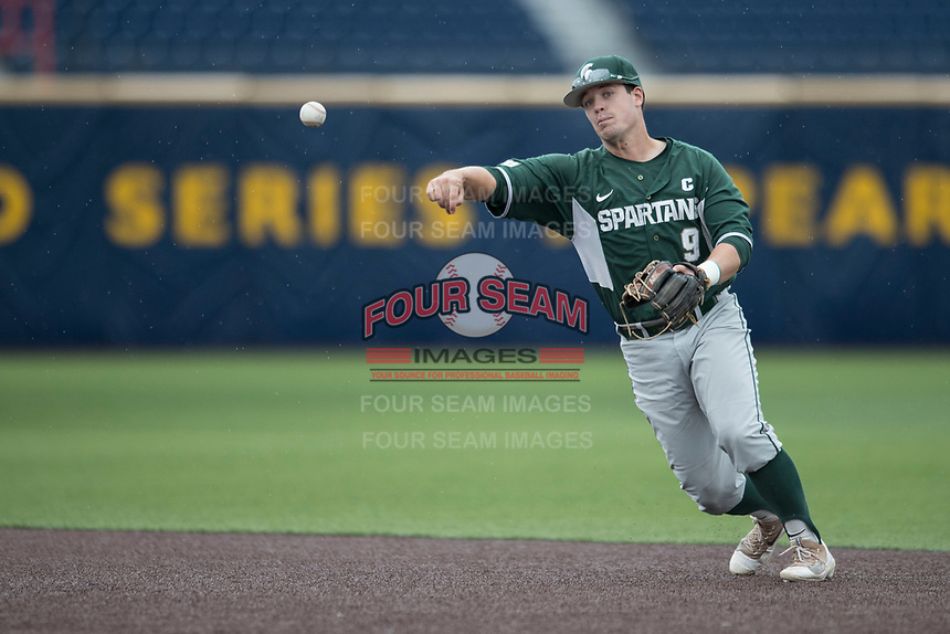 Michigan State Spartans second baseman Dan Durkin (9) makes a throw to first base against the Michigan Wolverines on May 19, 2017 at Ray Fisher Stadium in Ann Arbor, Michigan. Michigan defeated Michigan State 11-6. (Andrew Woolley/Four Seam Images)