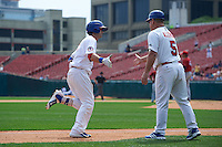 Buffalo Bisons first baseman Matt Hague (16) is congratulated by manager Gary Allenson (5) after hitting a home run during a game against the Columbus Clippers on July 19, 2015 at Coca-Cola Field in Buffalo, New York.  Buffalo defeated Columbus 4-3 in twelve innings.  (Mike Janes/Four Seam Images)