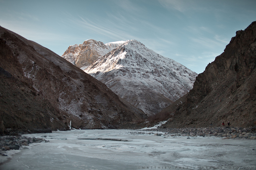 Early morning walk on the frozen Wakhan river..Trekking up to the Little Pamir with yak caravan over the frozen Wakhan river.