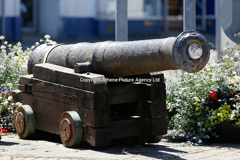 A canon on the roundabout of Fishguard Square, Pembrokeshire, Wales, UK