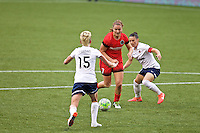 Portland, OR - Saturday, May 21, 2016: Portland Thorns FC midfielder Lindsey Horan (7) is marked by Washington Spirit midfielder Joanna Lohman (15) and defender Ali Krieger (11). The Portland Thorns FC defeated the Washington Spirit 4-1 during a regular season National Women's Soccer League (NWSL) match at Providence Park.