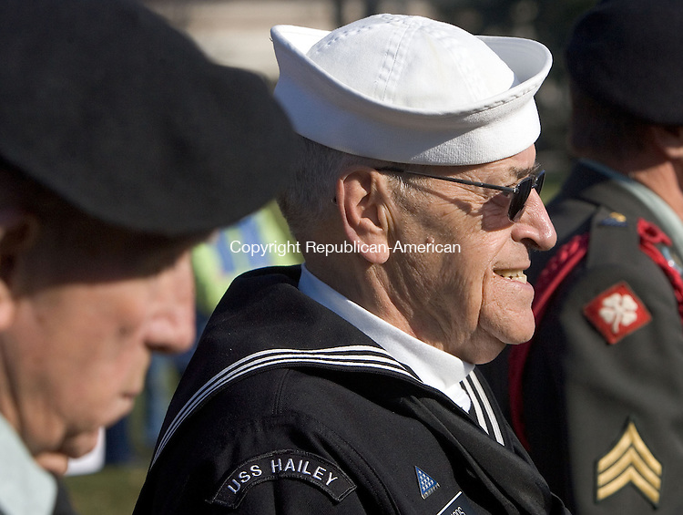 TORRINGTON, CT. 11 November 2012-111112SV10-Rene Richards of Torrington, 2nd class Boatswain's Mate USN retired, stands at attention with fellow veterans during the Veterans Day Ceremony at Coe Park in Torrington Sunday. Steven Valenti Republican-American