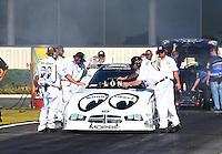Feb 6, 2015; Pomona, CA, USA; Crew members with NHRA funny car driver John Hale during qualifying for the Winternationals at Auto Club Raceway at Pomona. Mandatory Credit: Mark J. Rebilas-