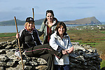 Hundreds of walkers donned their hiking boots and headed to the hills around Mount Brandon in West Kerry for the Dingle Walking Festival over the weekend. Our photograph shows Brid Noonand from Lispole, County Kerry and her daughters Niamh and Siobhan taking a well earned break at Monastic Site in West Kerry on Sunday..Picture by Don MacMonagle