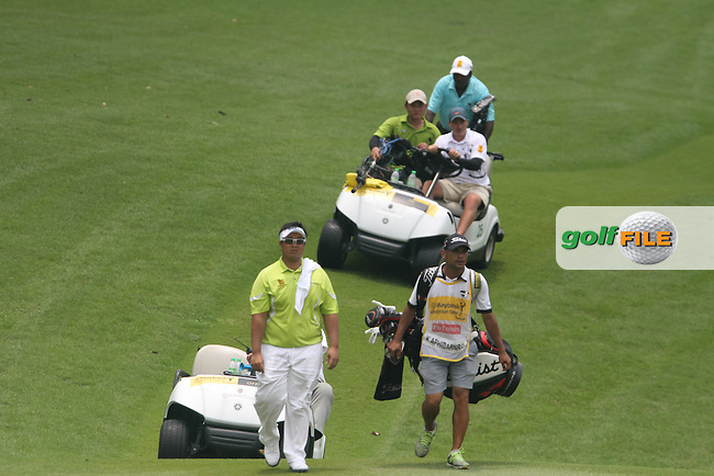 Kiradech Aphibarnrat (THA) on the 16th as play is suspended due to weather conditions during the resumed Round 3 of the 2013 Maybank Malaysian Open, Kuala Lumpur Golf and Country Club, Kuala Lumpur, Malaysia 24/3/13...(Photo Jenny Matthews/www.golffile.ie)