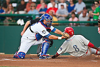 Catcher Chad Nobel #15 of the Daytona Cubs attempts to tag out Albert Cartwright #8 of the Clearwater Threshers during the game at Jackie Robinson Ballpark on May 3, 2012 in Daytona Beach, Florida. (Scott Jontes/Four Seam Images)