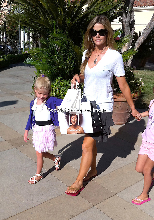 August 11th 2010  ...Denise Richards shopping at a store called Beauty Collection with her kids Sam Sheen & Lola Rose in Calabasas California. Denise's daughter played around with the makeup in the store & even put on some purple lipstick. The entire family was wearing sandals on this beautiful day. Denise just smiled & laughed when asked what she thought about Charlie's criminal troubles. Denise was probably laughing all the way to the bank after getting her huge child support & alimony settlement. ...AbilityFilms@yahoo.com.805-427-3519.www.AbilityFilms.com.
