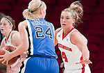 Wisconsin Badgers forward Tara Steinbauer (4) defends against Duke Blue Devils guard Kathleen Scheer (24) during an NCAA college women's basketball game during the ACC/Big Ten Challenge at the Kohl Center in Madison, Wisconsin on December 2, 2010. Duke won 59-51. (Photo by David Stluka)