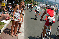 Spectators greet triathletes at the end of the bike course at Ironman France 2012, Promenade des Anglais, Nice, France, 24 June 2012
