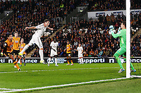 Angel Rangel of Swansea City has his header saved by Hull City goalkeeper Eldin Jakupovic during the Capital One Cup match between Hull City and Swansea City played at the Kingston Communications Stadium, Hull