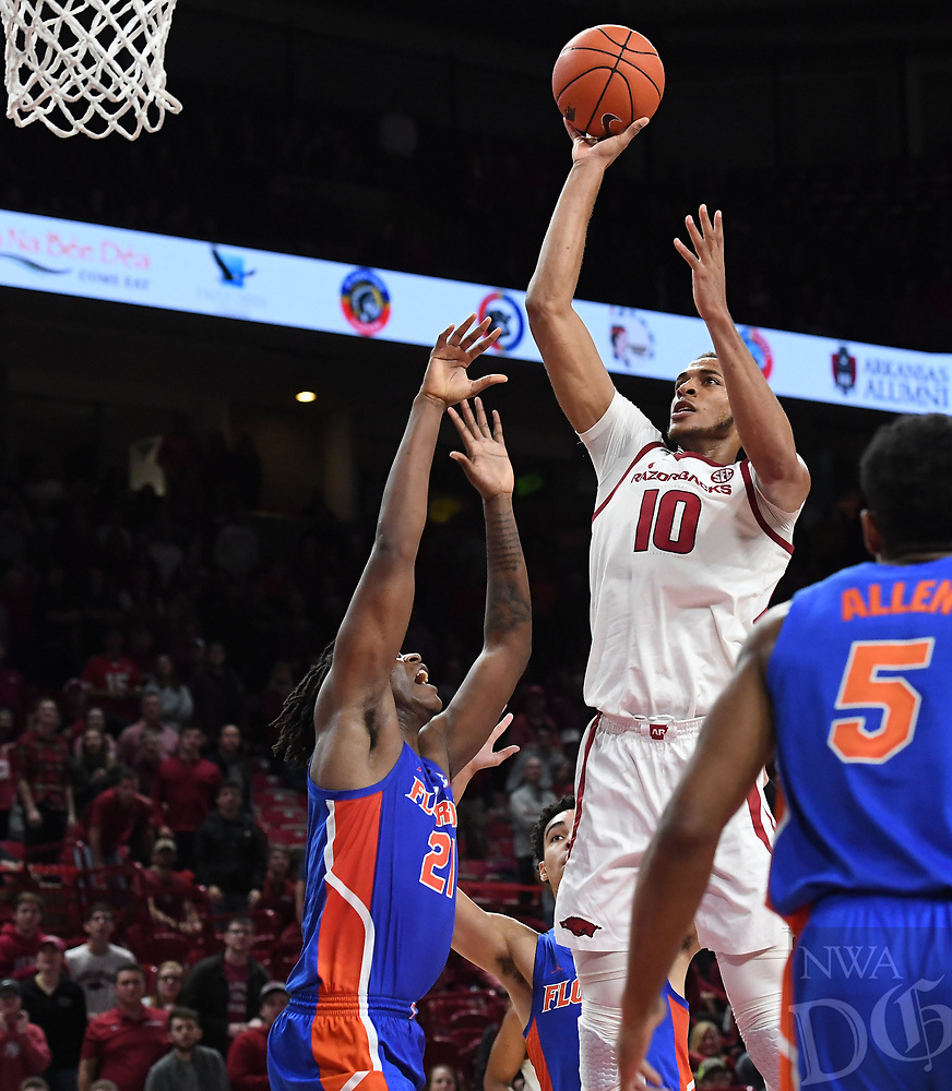 NWA Democrat-Gazette/J.T. WAMPLER Arkansas' Daniel Gafford takes a shot over Florida's Dontay Bassett Wednesday Jan. 9, 2019 at Bud Walton Arena in Fayetteville. Arkansas lost 57-51.