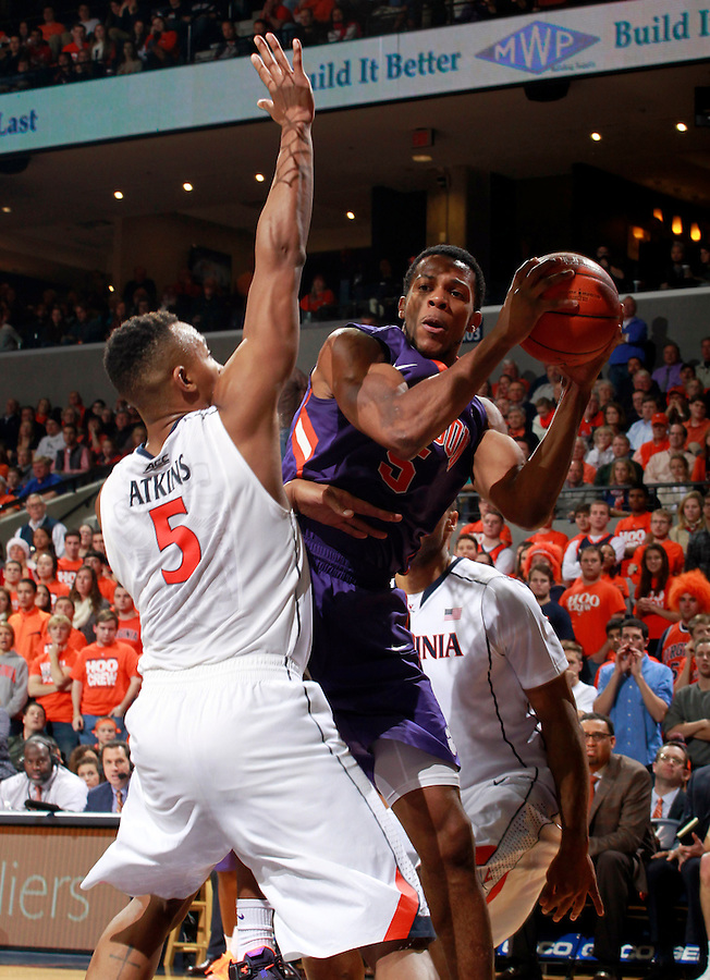 Virginia forward Darion Atkins (5) and Clemson forward Jaron Blossomgame (5) during an ACC basketball game Jan. 13, 2015 in Charlottesville, VA Virginia won 65-42.