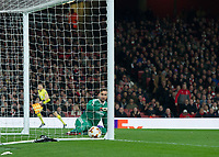 Gianluigi Donnarumma of AC Milan can only watch as the ball falls in the goal during the UEFA Europa League round of 16 2nd leg match between Arsenal and AC Milan at the Emirates Stadium, London, England on 15 March 2018. Photo by Vince  Mignott / PRiME Media Images.