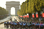 The peloton head up the Champs-Elysees toward the Arc de Triomphe during Stage 21 of the 2019 Tour de France running 128km from Rambouillet to Paris Champs-Elysees, France. 28th July 2019.<br /> Picture: ASO/Alex Broadway | Cyclefile<br /> All photos usage must carry mandatory copyright credit (© Cyclefile | ASO/Alex Broadway)