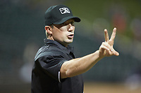 Home plate umpire Matthew Brown indicates that he needs two new baseballs during the Carolina League game between the Salem Red Sox and the Winston-Salem Dash at BB&T Ballpark on April 20, 2018 in Winston-Salem, North Carolina.  The Red Sox defeated the Dash 10-3.  (Brian Westerholt/Four Seam Images)