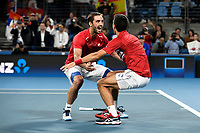 12th January 2020; Sydney Olympic Park Tennis Centre, Sydney, New South Wales, Australia; ATP Cup Australia, Sydney, Day 10; Serbia versus Spain; Viktor Troicki and Novak Djokovic of Serbia celebrate after their doubles victory over Spain to win the ATP Cup - Editorial Use