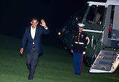 United States President Barack Obama waves as he walks from Marine One on the South Lawn of the White House in Washington, D.C., U.S., on Sunday, October 10, 2010. Obama returned from a trip to Philadelphia for a Democratic National Convention Rally..Credit: Joshua Roberts / Pool via CNP