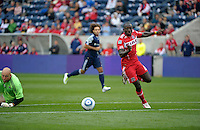 Chicago forward Dominic Oduro (8) moves to recover the ball after knocking it past New England goalkeeper Matt Reis.  Oduro would recover the ball and score on the play.  The Chicago Fire defeated the New England Revolution 3-2 at Toyota Park in Bridgeview, IL on Sept. 25, 2011.