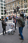 A TV camerman sets up a shot with a Thatcher supporter at Ludgate Circus before the funeral of Margaret Thatcher, London, 17 April 2013.<br />