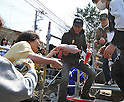 April 14, 2011, Ishonomaki, Japan - Japanese actor Hiroshi Tachi, centre, of Ishihara Promotion gives a helping hand to quake victims as he and fellow actor Tetsuya Watari run a soup kitchen in Ishonomaki, Miyagi Prefecture, on Thursday, April 14, 2011. The two big stars led Ishihara Promotion in providing meals for one week for the victims of March 11 earthquake and tsunami in this northeastern Japanese town. (Photo by AFLO) [3620] -mis-