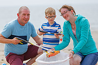 Pictured: William Mosley (C) collects litter from the beach with his mother Charlotte Heritage (R) and her partner Andy Faville (L). Saturday 09 June 2018<br /> Re: Four year old William Mosley who enjoys collecting plastic litter.