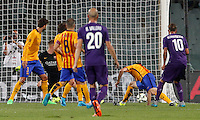 Calcio: amichevole Fiorentina vs Barcellona. Firenze, stadio Artemio Franchi, 2 agosto 2015.<br /> Fiorentina's Federico Bernardeschi, right, scores his second goal during the friendly match between Fiorentina and FC Barcelona at Florence's Artemio Franchi stadium, 2 August 2015.<br /> UPDATE IMAGES PRESS/Riccardo De Luca