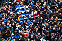 A Bath Rugby fan in the crowd waves a giant flag in support. Gallagher Premiership match, between Bath Rugby and Harlequins on March 2, 2019 at the Recreation Ground in Bath, England. Photo by: Patrick Khachfe / Onside Images