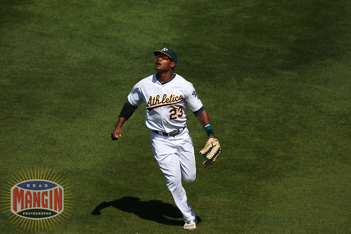 OAKLAND, CA - SEPTEMBER 7:  Michael Taylor #23 of the Oakland Athletics chases a fly ball in right field against the Kansas City Royals during the game at O.co Coliseum on September 7, 2011 in Oakland, California. Photo by Brad Mangin