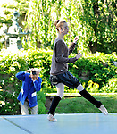 New York Times photographer Bill Cunningham photographs a dancer from the Tom Gold Dance company warming up before a performance in the garden at Kykuit in Pocantico Hills.